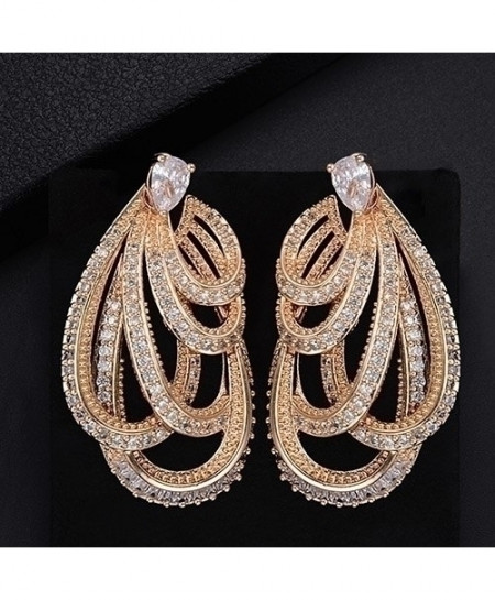 GODKI Golden Braided Twist Lines Paved Earrings